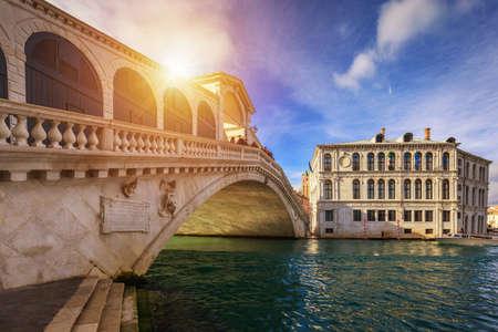 Rialto bridge in Venice, Italy. Venice Grand Canal. Architecture and landmarks of Venice. Venice postcard with Venice gondolas
