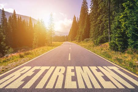 Retirement word written on road in the mountains Banco de Imagens