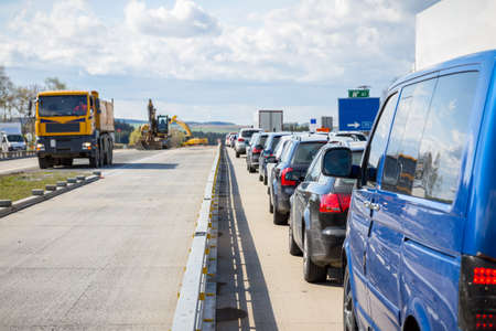 Cars line up on the freeway due to road construction