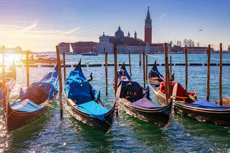 Sunny day in San Marco square, Venice, Italy. Venice Grand Canal. Architecture and landmarks of Venice. Venice postcard with Venice gondolas