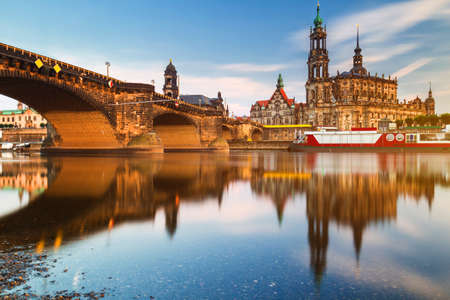 Augustus Bridge (Augustusbrucke) and Cathedral of the Holy Trinity (Hofkirche) over the River Elbe in Dresden, Germany, Saxony. Фото со стока