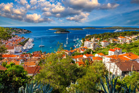 View at amazing archipelago in front of town Hvar, Croatia. Harbor of old Adriatic island town Hvar. Popular touristic destination of Croatia. Amazing Hvar city on Hvar island, Croatia. Фото со стока