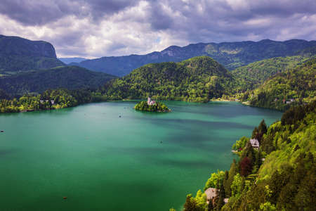 Lake Bled with St. Marys Church of Assumption on small island. Bled, Slovenia, Europe. The Church of the Assumption, Bled, Slovenia. The Lake Bled and Santa Maria Church near Bled, Slovenia. Banco de Imagens