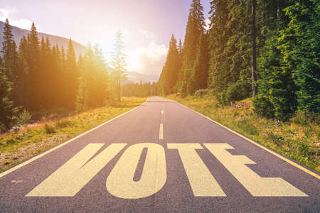 Vote word written on road in the mountains