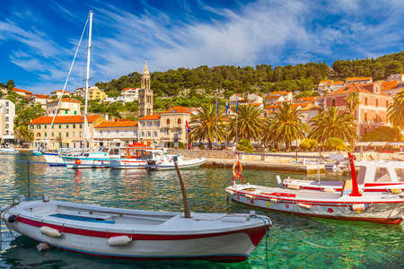 Colorful scenery in mediterranean town Hvar, famous travel place on Adriatic Sea, Croatia. Amazing Hvar city on Hvar island, Croatia. View of the Hvar town, Hvar island, Dalmatia, Croatia.