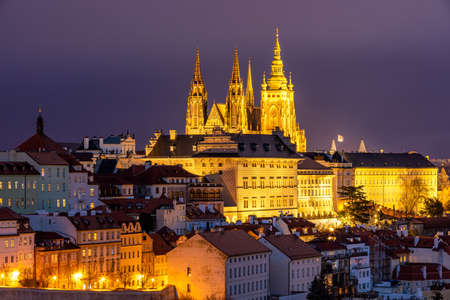 Prague Castle and Lesser Town panorama by night. View from Petrin Hill. Prague, Czech Republic. View of Prague Castle from Strahov monastery at night. Prague, Czech Republic