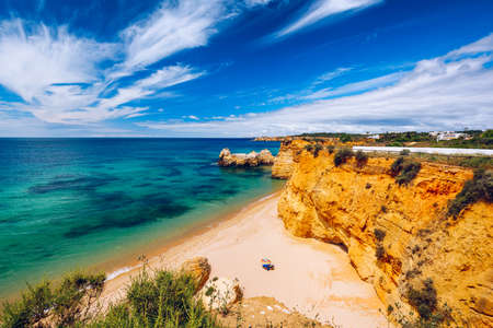 Praia dos Tres Castelos in south Portugal, Portimao, Algarve region. Landscape with Atlantic Ocean, shore and rocks in Tres Castelos beach (Praia dos Tres Castelos), Algarve, Portimao, Portugal.