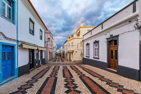 Street in the old town in the center of Lagos, Algarve region, Portugal. Narrow street in Lagos, Algarve, Portugal. Streets in the historic old town of Lagos, Algarve, Portugal. Stock Photo