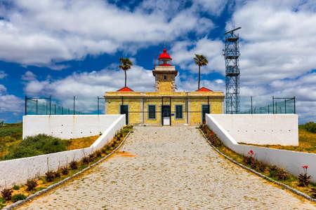 Ponta da Piedade Lighthouse in Lagos, Algarve, Portugal. Lighthouse at Ponta da Piedade in Lagos, Algarve region in Portugal. Banco de Imagens