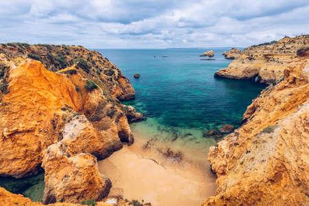 Submarino Beach (Praia do submarino  in portuguese), located in Alvor, region of Algarve, Portugal. Praia do Submarino, beautiful remote beach in Alvor, Algarve, Portugal. Imagens