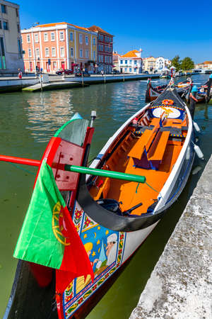 Traditional boats on the canal in Aveiro, Portugal. Banco de Imagens