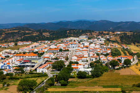 View to the small town of Aljezur with traditional portuguese houses and rural landscape, Algarve, Portugal.