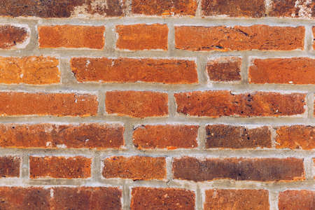 Old brick wall, old texture of red stone blocks closeup. The texture of the brick. Background of empty brick basement wall. Grunge red brick wall background with copy space.