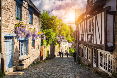 Narrow street with old traditional houses in histoical part of Dinan, Brittany (Bretagne), France