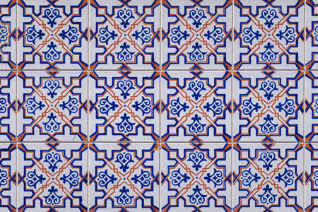 Azulejo is a form of Portuguese or Spanish painted, tin-glazed, ceramic tile work. Azulejos is traditional Portugese tiles in Aveiro. Architecture ornament. Aveiro, Portugal.