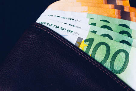 Wallet with Euro banknotes. Cash in the wallet on a black background. Euro money in leather wallet. Stock fotó