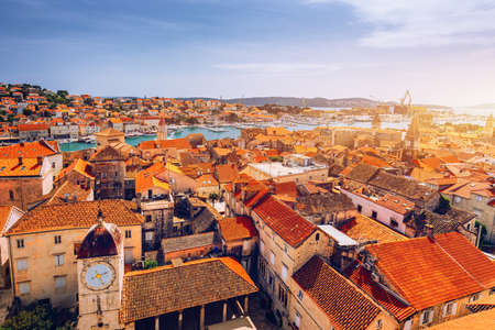 Historic buildings on promenade in Trogir, Croatia. Trogir is popular travel destination in Croatia. Trogir,  is one of most visited places in Dalmatia, Croatia. 写真素材