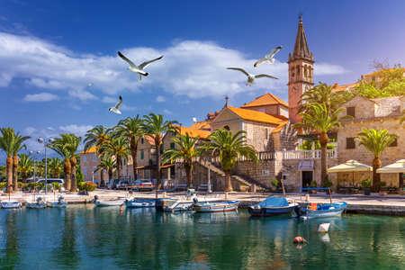 Splitska village with beautiful port and seagulls flying over the village, Brac island, Croatia. Fishing boats in Splitska village on Brac island seafront view, Dalmatia, Croatia, Croatia. 写真素材