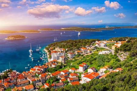View at amazing archipelago in front of town Hvar, Croatia. Harbor of old Adriatic island town Hvar. Popular touristic destination of Croatia. Amazing Hvar city on Hvar island, Croatia. 写真素材