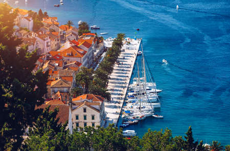 View at amazing archipelago with boats in front of town Hvar, Croatia. Harbor of old Adriatic island town Hvar. Popular touristic destination of Croatia. Amazing Hvar city on Hvar island, Croatia.