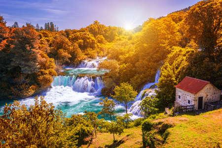 Krka national park with autumn colors of trees, famous travel destination in Dalmatia of Croatia. Krka waterfalls in the Krka National Park in autumn, Croatia.