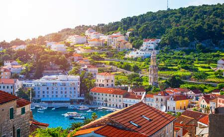 Colorful scenery in mediterranean town Hvar, famous travel place on Adriatic Sea, Croatia. Amazing Hvar city on Hvar island, Croatia. View of the Hvar town, Hvar island, Dalmatia, Croatia.