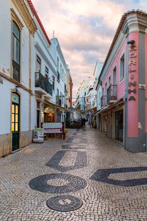 Lagos, Portugal - June 10, 2018: Street in the old town in the center of Lagos, Algarve region, Portugal. Narrow street in Lagos, Algarve, Portugal. Streets in the historic old town of Lagos.
