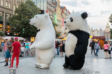 Prague, Czech Republic - May 26, 2018: Men dancing in a Polar bear and Panda bear fancy dress costumes entertains a crowd of people in Wenceslas Square. Prague, Czechia. Редакционное