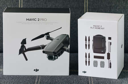 Prague, Czech Republic - August 31 , 2018: DJI new drone Mavic 2 Pro boxed and DJI Mavic 2 Fly More Kit on display.