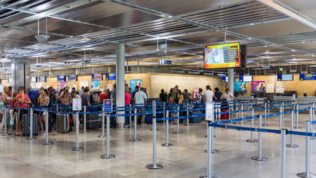 Nuremberg, Germany - May 6, 2018: Passengers queuing up in check-in counter in the Nuremberg Airport. Crowd of people at airport. People waiting in queue for check-in. Nuremberg, Germany.