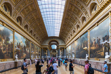 Versailles, France - July 7, 2018 : The Battle Gallery in the southern wing of Palace of Versailles, the residence of the sun king Louis XIV.  The Battle Gallery (Galerie des Batailles), Versailles.