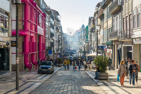 Porto, Portugal - November 17, 2017: Shoppers stroll on Rua Santa Catarina pedestrian street. View of the commercial street called Santa Catarina (Saint Catherine) with many small shops and always with lots of people Publikacyjne