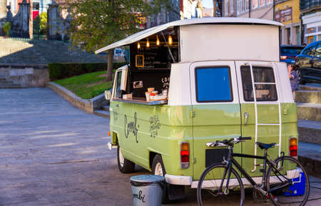 Porto, Portugal - November 15, 2017: Food truck selling coffee, limonade, drinks and sweets parked on the streets in the beautiful city of Porto, Portugal.