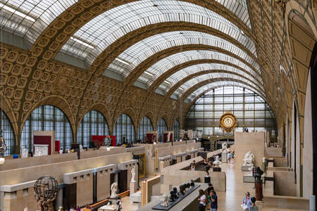 Paris, France - July 5, 2018: Visitors at the Musee dOrsay in Paris. Located in the former Gare dOrsay train station, the museum has the largest collection of impressionist paintings in the world.