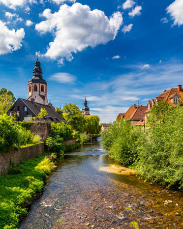 Old city of Ettlingen in Germany with a river and a church. View of a central district of Ettlingen, Germany, with a river and a bell tower of a church. Ettlingen, Baden Wurttemberg, Germany. 스톡 콘텐츠