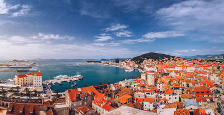 Split waterfront and Marjan hill aerial view, Dalmatia, Croatia. Panoramic summer cityscape of old medieval city Split, Croatia, Europe.  Traveling concept background.