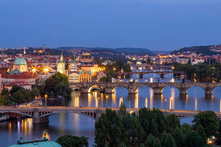 Scenic view of the Old Town pier architecture and Charles Bridge over Vltava river in Prague, Czech Republic. Prague iconic Charles Bridge (Karluv Most) and Old Town Bridge Tower at sunset, Czechia.
