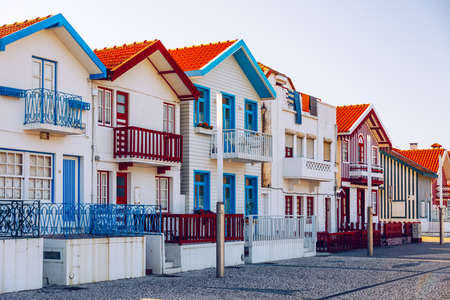 Street with colorful houses in Costa Nova, Aveiro, Portugal. Street with striped houses, Costa Nova, Aveiro, Portugal. Facades of colorful houses in Costa Nova, Aveiro, Portugal. Zdjęcie Seryjne
