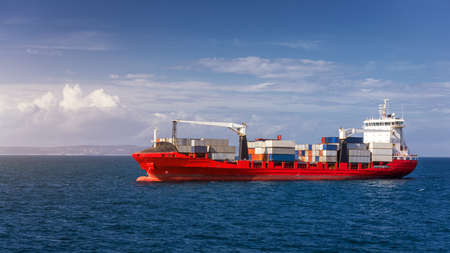 Container cargo ship, import export business logistic and transportation of International by container ship in the open sea. Logistics and transportation of International Container Cargo ship.