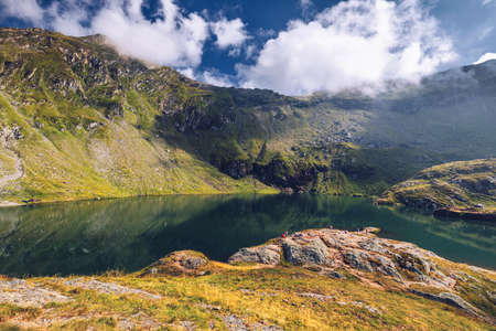 Balea glacier lake near the Transfagarasan road, panoramic view. Balea Lake, is a glacier lake situated at 2034m of altitude in the Fagaras Mountains, in central Romania, Sibiu County.