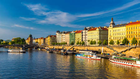 Scenic embankment in Prague city; Historical center of Prague, buildings and landmarks of old town, Prague, Czech Republic. Embankment of the Vltava river in Prague, the capital of Czechia. 免版税图像