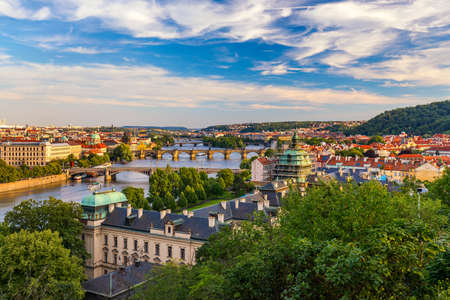 Scenic view on Vltava river and historical center of Prague, buildings and landmarks of old town, Prague, Czech Republic. Charles Bridge (Karluv Most) and Lesser Town Tower, Prague, Czechia