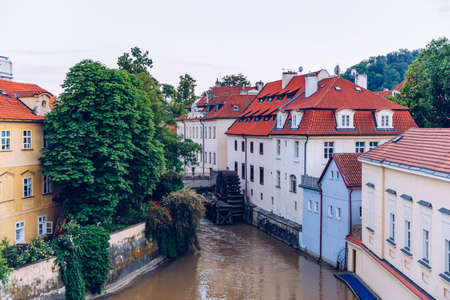Historic water mill in Prague, water mill, Czech Republic. Old water mill at center of the Prague. Czechia. Mill Wheel of Velkoprevorsky Mill on Chertovka River in Prague, Czech Republic Stock Photo