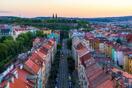 View of Prague taken from Nuselsky bridge (Nusle Bridge). Famous Vysehrad fort is behind it with Basilica of St. Peter and St. Paul. The Nusle Distric cityscape as seen from Vysehrad. Prague, Czechia.