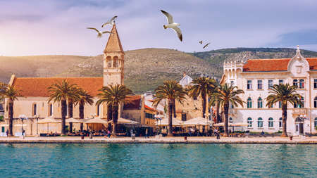 View at town Trogir, old touristic place in Croatia Europe. Trogir town coastal view. Magnificent Trogir, Croatia. Sunny old Venetian town, Dalmatian Coast in Croatia. Seagulls flying over Trogir.