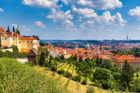 Prague Castle and Lesser Town panorama. View from Petrin Hill. Prague, Czech Republic. Spring Prague panorama from Prague Hill with Prague Castle, Vltava river and historical architecture. Czechia. Stock fotó