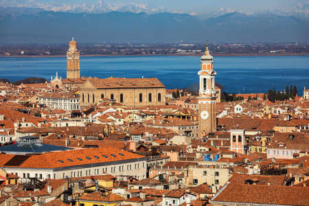 Venice panoramic aerial view with red roofs, Veneto, Italy. Aerial view of the Venice city, Italy. Venice is a popular tourist destination of Europe. Venice, Italy.