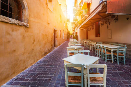 Street in the old town of Chania, Crete, Greece. Charming streets of Greek islands, Crete. Beautiful street in Chania, Crete island, Greece. Summer landscape. Chania old street of Crete island Greece. Stock Photo