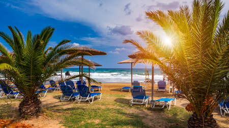 View of sunbeds awaiting tourists at the Greek island resort of Georgioupolis on Crete north coast. Georgioupoli is a resort village and former municipality in the Chania regional unit, Crete, Greece. 写真素材