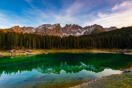 Carezza lake (Lago di Carezza, Karersee) with Mount Latemar, Bolzano province, South tyrol, Italy. Landscape of Lake Carezza or Karersee and Dolomites in background, Nova Levante, Bolzano, Italy.